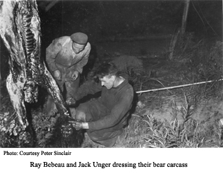 Raty Bebeau and Jack Unger dressing bear